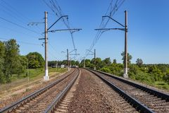 Contact wires and broad gauge rails in the perspective of the spring day. industry railway transportation, logistics. Moscow. Region Russia stock photo