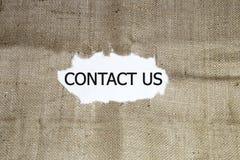 Contacte-nos palavra escrita Imagem de Stock