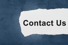 Contactez-nous avec des larmes de livre blanc Photos libres de droits