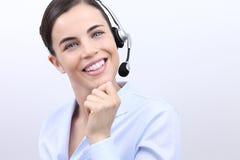 Contactez-nous, femme d'opérateur de service client avec le sourire de casque photographie stock libre de droits