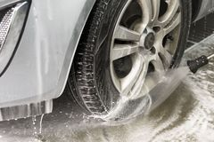 Contactless car wash with high pressure, water and foam Stock Photo