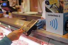 Contactless 012. A customer pays using the contactless payment system, an improved no identity check payment option for low expenditures Royalty Free Stock Images