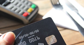 Contactless payment card pdq background copy space with hand holding credit card to pay. Contactless payment card pdq background copy space with hand holding stock photography