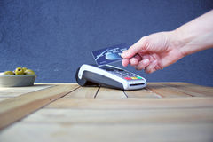 Contactless payment card pdq background copy space with hand holding credit card to pay. Contactless payment card pdq with hand holding credit card ready to pay Royalty Free Stock Photos