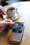 Contactless payment card pdq background copy space with hand holding credit card to pay. Contactless payment card pdq with hand holding credit card ready to pay Royalty Free Stock Photo