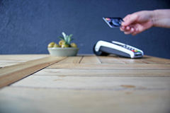 Contactless payment card pdq with hand holding credit card to pay. Contactless payment card pdq with hand holding credit card ready to pay Royalty Free Stock Image