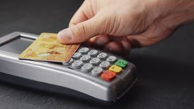 Contactless payment with credit card. Closeup shot of person using contactless payment with credit card stock video footage