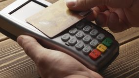 Contactless payment with credit card. Closeup shot of person using contactless payment with credit card stock video