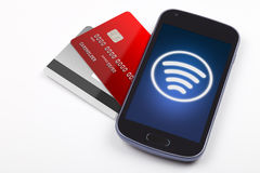 Contactless payment with mobile phone. Sending contactless payment with a mobile phone. Credit cards, shown alongside Royalty Free Stock Photo