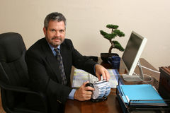 Contacts. Business man looking at camera, scrolling through contacts Stock Photography