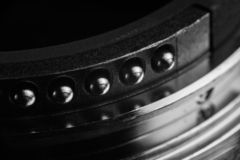 The contacts of the lens mount. Contacts from metal of silver color of a bayonet of a lens. Contacts act and round shape stock image