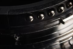 The contacts of the lens mount. Contacts from metal of silver color of a bayonet of a lens. Contacts act and round shape stock photo