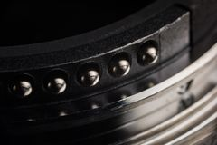 The contacts of the lens mount. Contacts from metal of silver color of a bayonet of a lens. Contacts act and round shape royalty free stock photos