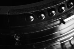 The contacts of the lens mount. Contacts from metal of silver color of a bayonet of a lens. Contacts act and round shape stock photography