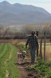Contadino con il cane del documentalista Immagine Stock Libera da Diritti