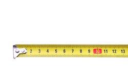 Contador de medición amarillo aislado de la regla de la cinta Imagen de archivo libre de regalías