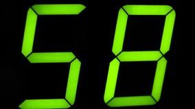 Contador de tiempo macro del contador del reloj digital Dígito verde almacen de video