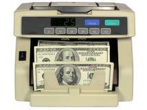 Contador electrónico del dinero en circulación con los dólares Fotos de archivo libres de regalías