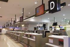 Contadores de enregistramiento en el aeropuerto de Melbourne Imágenes de archivo libres de regalías