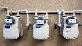 Contadores eléctricos y de gas imagen de archivo