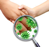 Contagious Infection. Contagious virus infection with children hands holding and touching spreading dangerous infectious germs and bacteria with a magnifying Royalty Free Stock Photo
