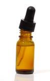Contagoccia e bottiglia Fotografie Stock