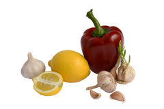 Contain vitamin C. Paprika, garlic and lemon isolated on white background Stock Photography