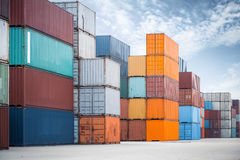 Container against a blue sky. Some container stacking in freight yard ,transport concept Stock Photo