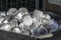 Container with aluminum waste Stock Photos