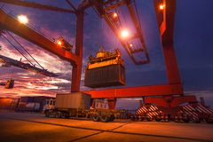 Container terminal. The container being hoisted at the dock Royalty Free Stock Images