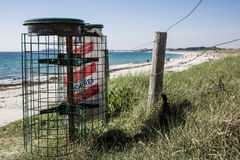 Container bin on the beach Stock Image