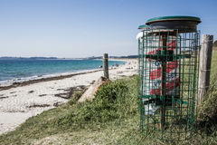 Container bin on the beach Stock Photos