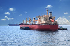Container boat loading goods over clear blue water sea use for v Royalty Free Stock Photography