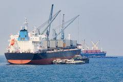 Container boat loading goods over clear blue water sea use for v Royalty Free Stock Photos