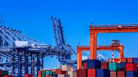 Container cargo freight ship in container terminal. Yard in sea port royalty free stock images