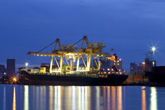 Container Cargo freight ship with working crane Royalty Free Stock Photography