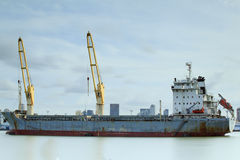 Container Cargo freight ship with working crane Royalty Free Stock Photos