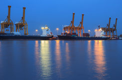 Container cargo freight ship with working crane br royalty free stock photos