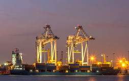 Container Cargo freight ship with working crane bridge in shipya Royalty Free Stock Images