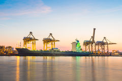 Container Cargo freight ship with working crane bridge in shipya Royalty Free Stock Photos