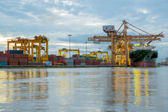 Container Cargo freight ship working crane bridge in shipyard Royalty Free Stock Photo