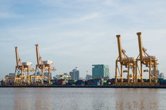 Container Cargo freight ship with working crane bridge in shipyard Royalty Free Stock Image
