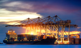 Container Cargo freight ship with working crane bridge Stock Image