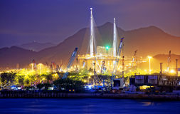 Container Cargo freight ship with working crane bridge Royalty Free Stock Photography