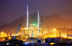 Container Cargo freight ship with working crane bridge Stock Images