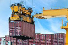 Container Cargo freight ship with working crane loading bridge i Royalty Free Stock Photo