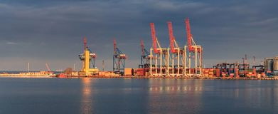 Container Cargo freight ship with working crane stock photos