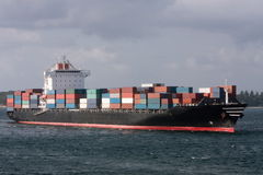 Container cargo ship entering port Royalty Free Stock Photo