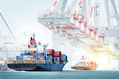 Container cargo ship entering the port with harbor crane background. Freight Transportation. Royalty Free Stock Photography