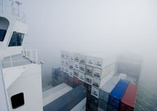 Container Cargo Ship in fog Royalty Free Stock Photography